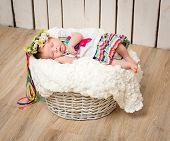 newborn girl sleeping in the Ukrainian national costume