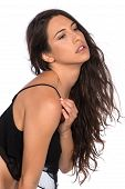 stock photo of camisole  - Pretty young brunette in a black camisole bra - JPG