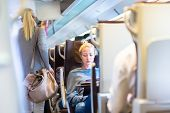 stock photo of passenger train  - Blonde casual caucasian lady traveling by train - JPG