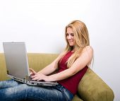 Beautiful blonde girl with a laptop