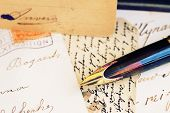 quill pen and antique letters
