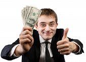 Businessman In Suit Showing Fan Of Money