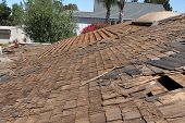 Home Roof Construction Site. Removal of old roof and replacement with all new materials. Roofs are a