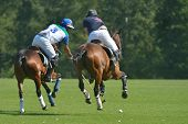 TSELEEVO, MOSCOW REGION, RUSSIA - JULY 26, 2014: Misha Rodzianko (left) of Moscow Polo Club and Ollie Browne of British Schools in action during the British Polo Day. Moscow Polo Club won 7-6
