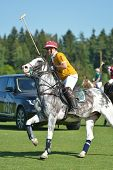 TSELEEVO, MOSCOW REGION, RUSSIA - JULY 26, 2014: Boris Osoyev of Tseleevo Polo club warms up before the match against the Oxbridge polo team during the British Polo Day. Oxbridge won 5-4