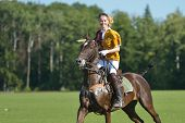 TSELEEVO, MOSCOW REGION, RUSSIA - JULY 26, 2014: Aliona Chekhova of Tseleevo Polo club after the match against the Oxbridge polo team during the British Polo Day. Oxbridge won 5-4