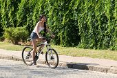 Girl Driving On Bicycle