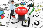 The word share and happy businessman standing with hands in pockets against digitally generated red push button