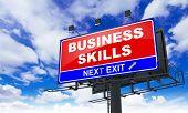 Business Skills on Red Billboard.