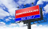 pic of benchmarking  - Benchmarking Inscription on Red Billboard on Sky Background - JPG