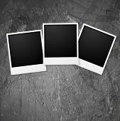 Polaroid photo frames on grunge wall. Vector background