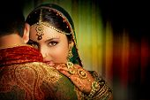 stock photo of sari  - an Indian woman wearing a traditional clothing and jewelry - JPG