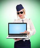 Stewardess Holding Blank Laptop