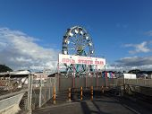 Entrance With Sign To Annual 50Th State Fair With Ferris Wheel At The Aloha Stadium Parking Lot