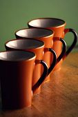row of coffee mugs