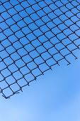 Wire Mesh Of Blue Sky