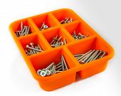 Orange Box Of Screws On White Background 02