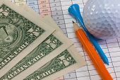 Golf Equipments And Us Dollar Banknotes