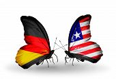 Two Butterflies With Flags On Wings As Symbol Of Relations Germany And Liberia
