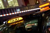 stock photo of london night  - Low key detail of London black cab sign turned on at night - JPG