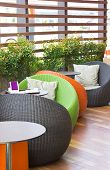 Colorful Modern Weaved Oval Chairs With Tables.