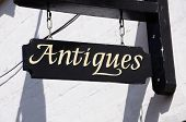 Wooden antiques sign.