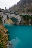 stock photo of na  - Turquise water in Soca river in Most Na Soci town,Slovenia.