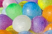 Rainwater Falling Over Colored Balloons