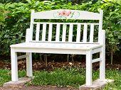 White Wooden Chair In Garden.