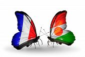 Two Butterflies With Flags On Wings As Symbol Of Relations France And Niger