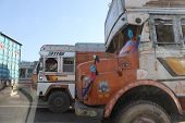 Traditionally Decorated Indian Trucks On The Street Of Jaipur