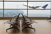 stock photo of terminator  - View from the airport terminal to a departing plane - JPG