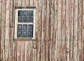 barn board with frosty window
