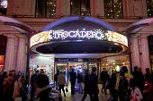 LONDON, UK - JANUARY 02: Busy street in front of entrance to London Trocadero shopping centre. January 02, 2015 in London.