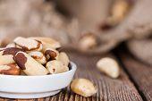 stock photo of brazil nut  - Some Brazil Nuts on vintage wooden background - JPG