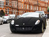 LONDON, UK - CIRCA AUGUST 2013: A Ferrari 599 GTB Fiorano with a black velvet wrap.