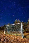 Soccer pitch under starry sky at night