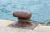 picture of bollard  - Old mooring bollard and chain in port Croatia - JPG