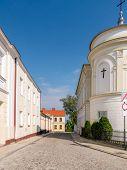 Cobblestone old town Sandomierz street with restored historical tenaments , Poland
