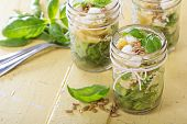 stock photo of pea  - Pasta salad in jars with farfalle - JPG
