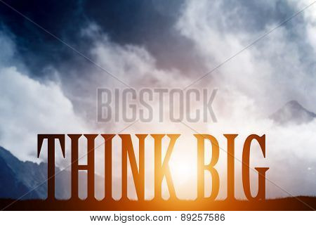 THINK BIG text on mountains landscape at sunset dramatic sky. Motivational, inspirational