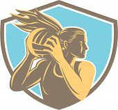 stock photo of netball  - Illustration of a netball player catching rebounding ball looking to the side set inside shield crest on isolated background - JPG