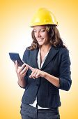 foto of overspending  - Female builder with calculator on white - JPG