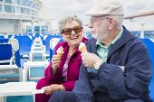 image of passenger ship  - Happy Senior Couple Enjoying Ice Cream On The Deck of a Luxury Passenger Cruise Ship - JPG