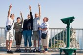 stock photo of gibraltar  - Portrait of happy excited tourists people on the Rock of Gibraltar - JPG