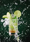 image of freeze  - fresh mojito drink with liquid splash and drift - JPG
