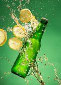 picture of freeze  - Green beer bottle with splashing liquid - JPG