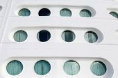 picture of cruise ship caribbean  - Portholes in the front of a massive luxury cruise ship - JPG