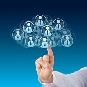 stock photo of blue-collar-worker  - Index finger of a white collar worker touching human resources icons that shape a virtual cloud - JPG