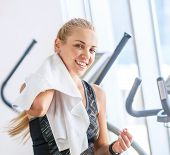 image of treadmill  - Attractive blonde female with towel after Treadmill exercise - JPG